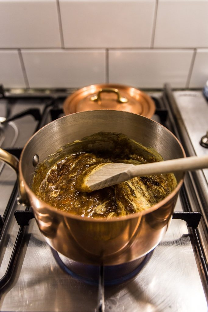 mauviel copper pot on stove with glaze mix