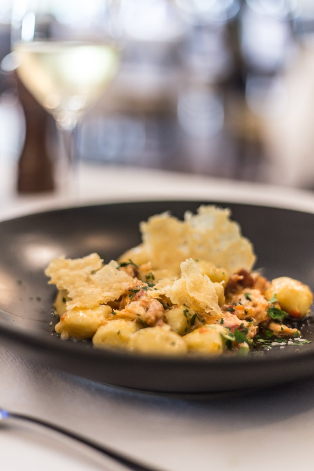Cottonwood & Co - Potato gnocchi with rabbit ragu, pancetta, green olives, rosemary & parmesan crisp, dining at Bells at Killcare