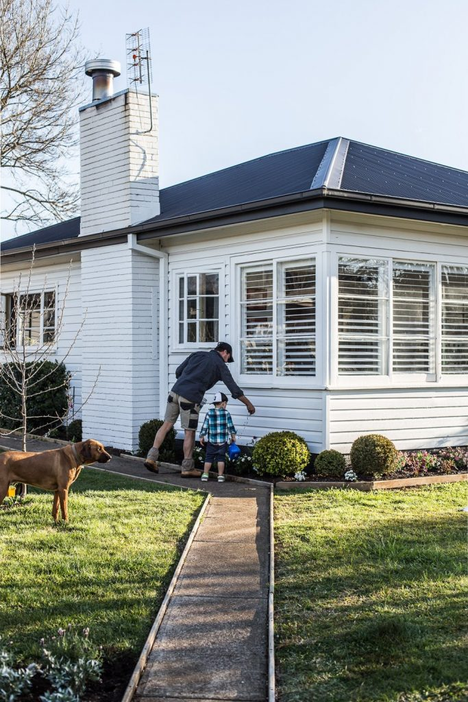 white cottage weatherboard and garden